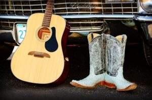 quitar-cowboy-boots-country-music-cadillac