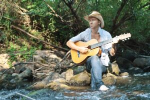 stream-music-guitar-cowboy-hat-country